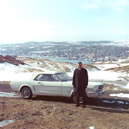 Captain Stanley Tucker with 1965 Mustang serial number 1