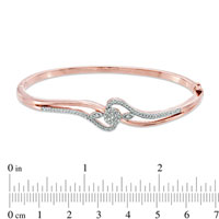 Bracelets - 1/4  CT.  T. W.  DIAMOND CLUSTER BANGLE IN STERLING SILVER AND 14 K ROSE GOLD PLATE BRACELET alternate image 1.