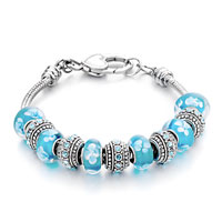 - aquamarine murano glass combined with silver tone beads charm Image.