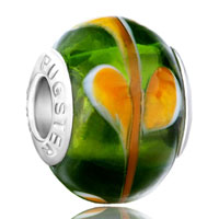 - dark green murano glass with orange petal pattern Image.