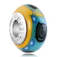 European Beads - black whirlpool and blue dots against pale green yellow polymer clay beads charms bracelets Image.